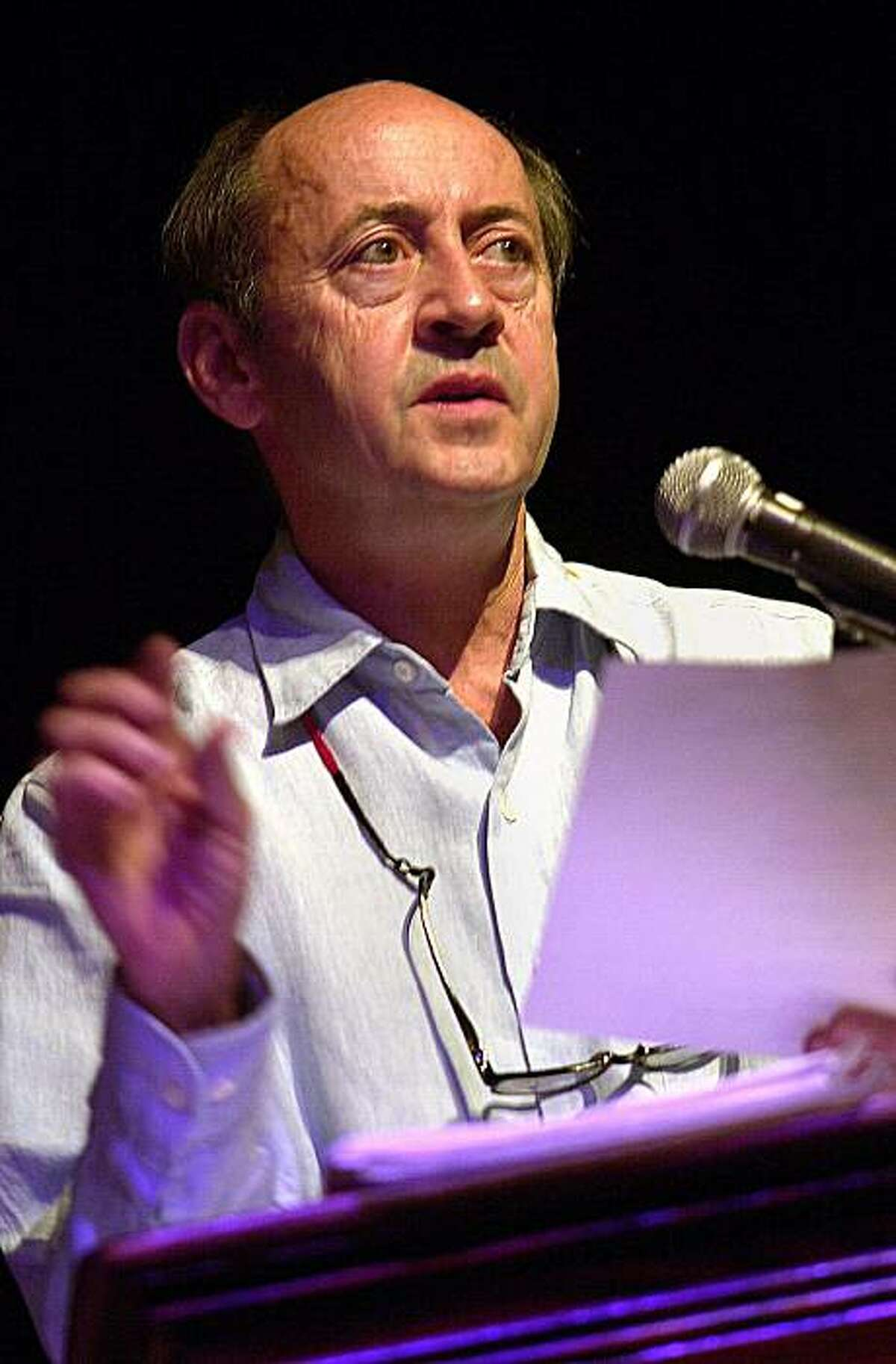 In this Aug. 26, 2001 file photo, poet Billy Collins reads his work during a poetry fair in Woodstock, N. Y..