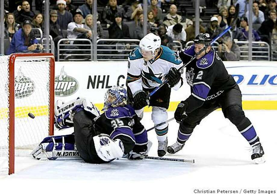 LOS ANGELES, CA - DECEMBER 15:  Milan Michalek #9 of the San Jose Sharks shoot the puck wide of goaltender Jason LaBarbera #35  of the Los Angeles Kings as Matt Greene #2 defends during the NHL at Staples Center on December 15, 2008 in Los Angeles, California.  The Sharks defeated the Kings 3-2 in overtime shootout.  (Photo by Christian Petersen/Getty Images) Photo: Christian Petersen, Getty Images