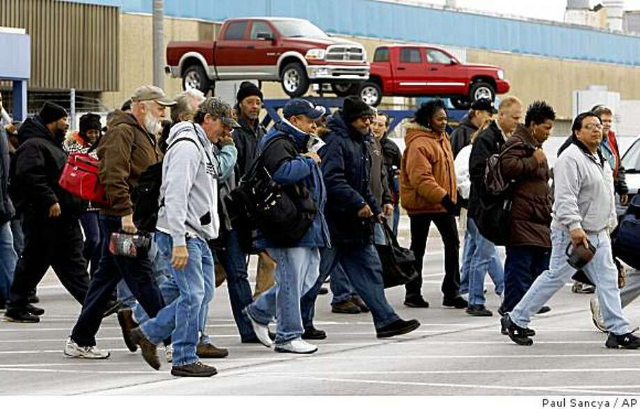Workers leave the Chrysler Truck Assembly plant in Warren, Mich., Thursday, Dec. 11, 2008. Prospects for a $14 billion auto industry rescue bill dimmed Thursday amid growing opposition in both parties and despite urgent appeals by both President-elect Barack Obama and President George W. Bush. (AP Photo/Paul Sancya) Photo: Paul Sancya, AP