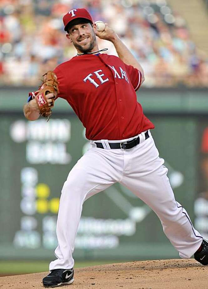 Texas Rangers new pitcher Cliff Lee throws a pitch in the first inning of a MLB game against the Los Angeles Angels at Rangers Ballpark in Arlington, Texas, Thursday, July 22, 2010. (Max Faulkner/Fort Worth Star-Telegram/MCT) Photo: Max Faulkner, MCT