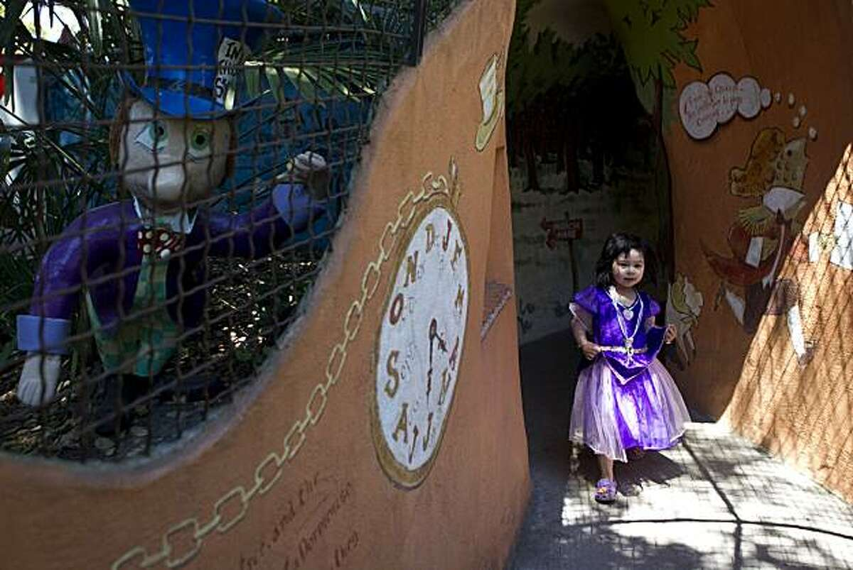 Crystal Tse. age 3, walks through the Alice in Wonderland Tunnel at Children's Fairyland in Oakland, Calif., on Thursday, July 15, 2010. Children's Fairyland opened in 1950 and was America's first storybook theme park.