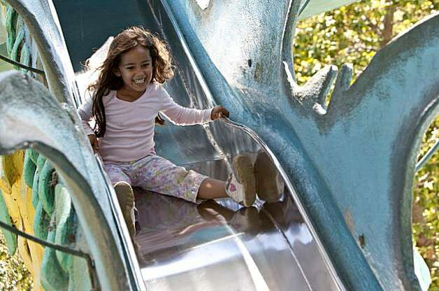 Reanna Soltero, age 5, rides the Dragon Slide at Children's Fairyland in Oakland, Calif., on Thursday, July 15, 2010.  Children's Fairyland opened in 1950 and was America's first storybook theme park. Photo: Laura Morton, Special To The Chronicle