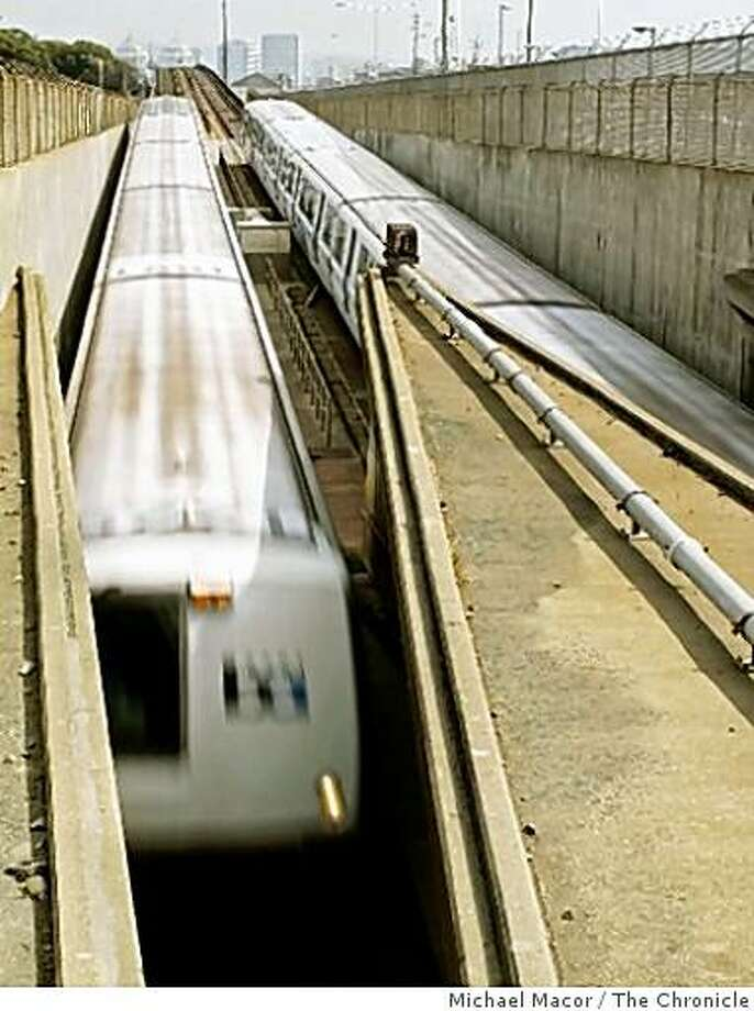 BART trains move into and out of the West Portal tunnel in West Oakland, Calif., on Mar. 7, 2008. Photo: Michael Macor, The Chronicle