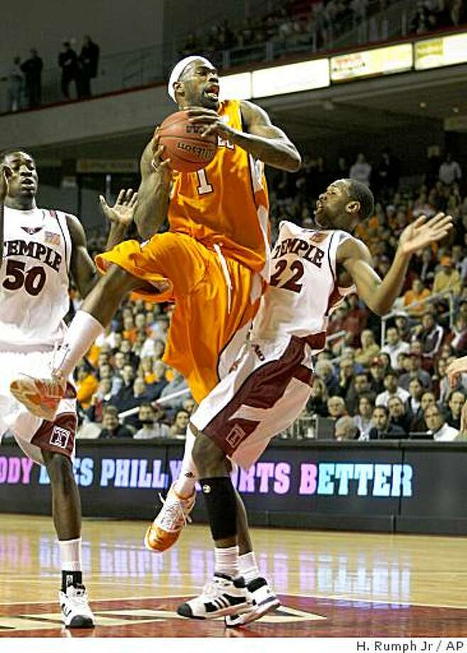 Tennessee's Tyler Smith (1) looks to pass as Temples' Dionte Chrismas (22) defends during the first half of an NCAA college men's basketball game Saturday, Dec. 13, 2008, in Philadelphia. (AP Photo/H. Rumph Jr) Photo: H. Rumph Jr, AP