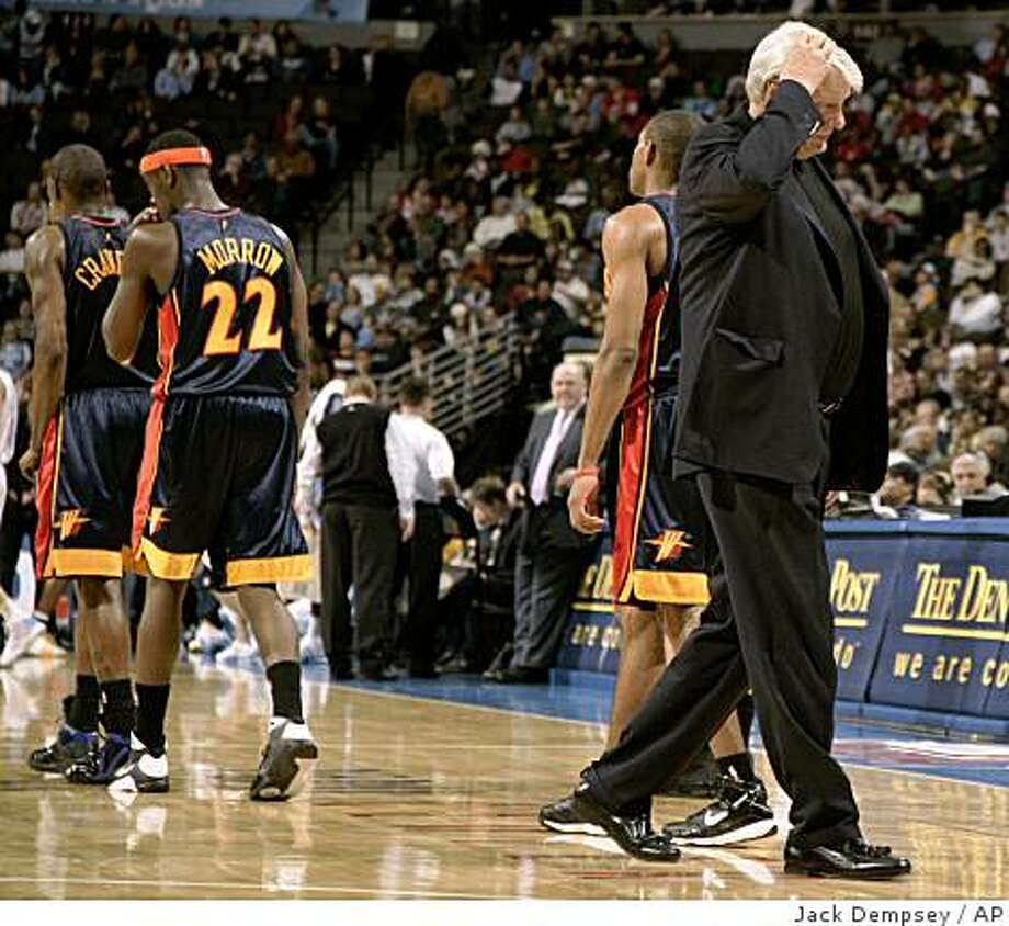 Don Nelson, right, head coach of the Golden State Warriors, reacts after a time-out during the fourth period of an NBA basketball game against the Denver Nuggets in Denver, Saturday, Dec. 13, 2008. (AP Photo/Jack Dempsey) Photo: Jack Dempsey, AP