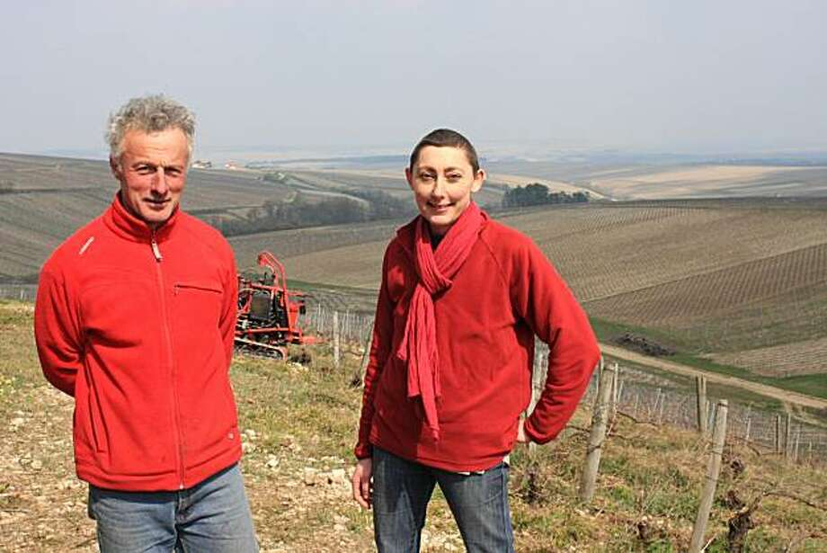 Olivier and Alice De Moor stand in one of their Chablis vineyards near Courgis, France. Photo: Jon Bonne, The Chronicle