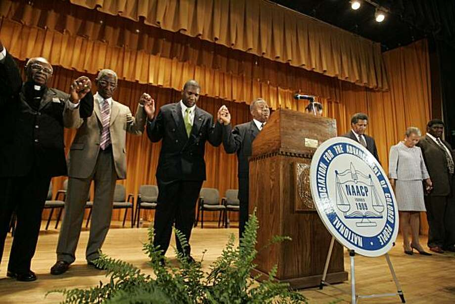 Alvin Greene, Third from the left, Democratic candidate for the U.S. Senate, stands with others after  making his first public speech during the monthly meeting of the NAACP Sunday, July 18, 2010, at Manning Junior High School, in Manning, S.C. Photo: Mary Ann Chastain, AP
