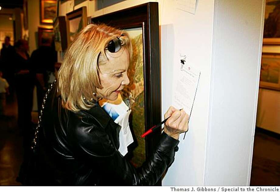 Academy of Art AuctionCarole McNeil making a silent auction bid.SAN FRANCISCO, CA (November 17, 2008) ? On Saturday, November 8, 2008, more than 200 art collectors, dealers, and enthusiasts gathered at the Academy of Art University for its highly anticipated 13th Annual Faculty & Alumni Fine Art Auction. Exhibiting approximately 350 works of fresh paintings, sculpture, and jewelry by nationally esteemed AAU faculty and alumni, this year?s auction achieved an extraordinary $159,000 in fine art sales.  The artists of top-grossing works included Zack Zdrale, Earl Enriquez, and Brian Blood.  With special thanks to Bonhams & Butterfields, an enthusiastic art collecting community from across the country generously expressed their support for students pursuing their fine art education at AAU. As in past years, half of the proceeds from the 13th Annual Faculty & Alumni Fine Art Auction benefit students through the Fine Art Student Scholarship Fund, with the rest going directly to the artists themselves. Photo: Thomas J. Gibbons, Special To The Chronicle