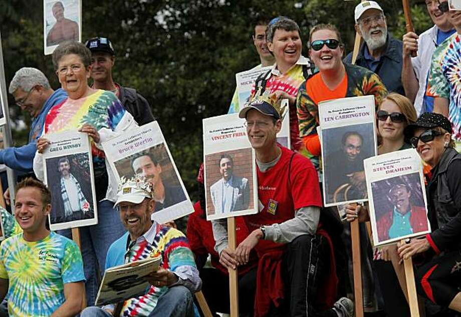 Walkers from the St. Francis Lutheran Church and the San Francisco State Geography department hold photos of AIDS victims as they pose for a picture. The 24th annual AIDS walk attracted thousands to Golden Gate Park in San Francisco on Sunday. Photo: Brant Ward, The Chronicle