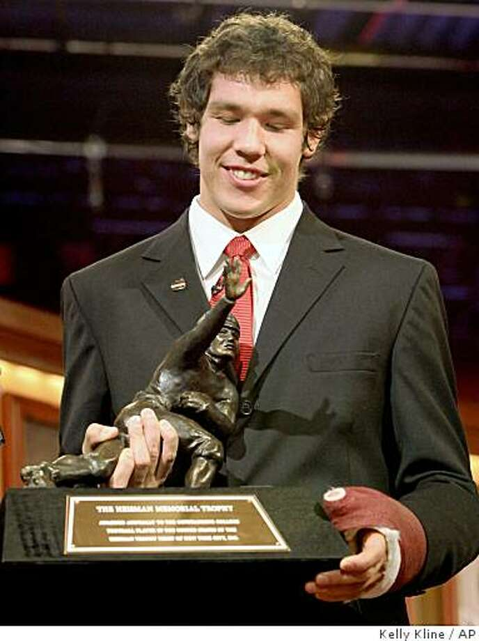 Oklahoma football player Sam Bradford holds the Heisman Trophy after he was presented the award at a ceremony Saturday, Dec. 13, 1008 in New York.  (AP Photo/Kelly Kline, Pool) ** POOL PHOTO ** Photo: Kelly Kline, AP