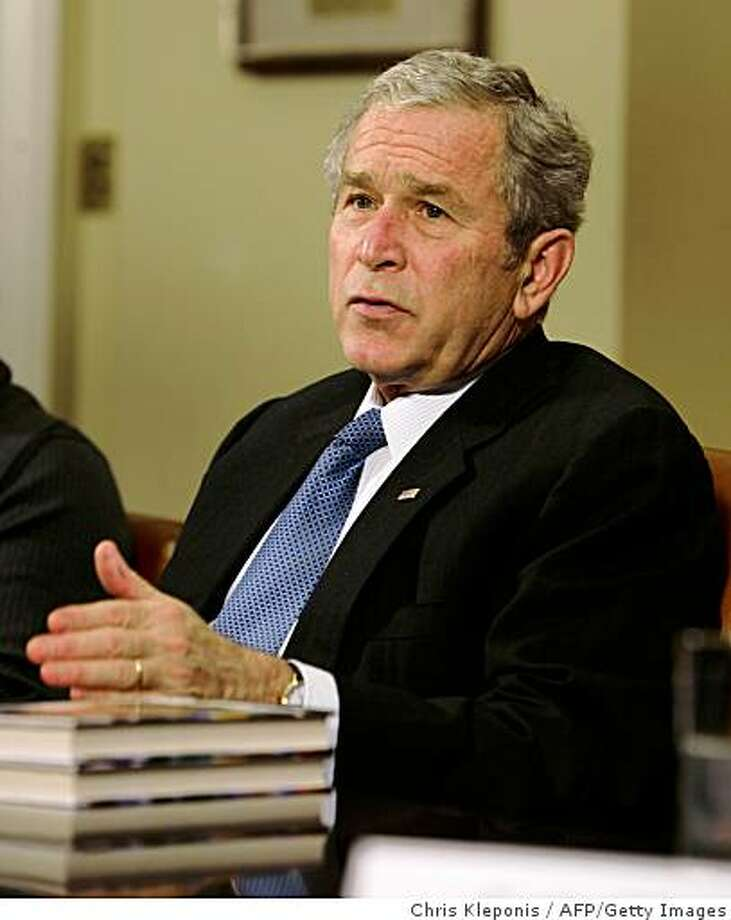 US President George W. Bush speaks at the conclusion of a meeting with people in recovery, leaders in drug prevention, treatment and law enforcement at The White House on December 11, 2008 in Washington, DC. During the meeting, they spoke of some success in the decline in the use of drugs in the nation and efforts to continue efforts to reduce drug use by youths. AFP PHOTO/ Chris Kleponis (Photo credit should read CHRIS KLEPONIS/AFP/Getty Images) Photo: Chris Kleponis, AFP/Getty Images