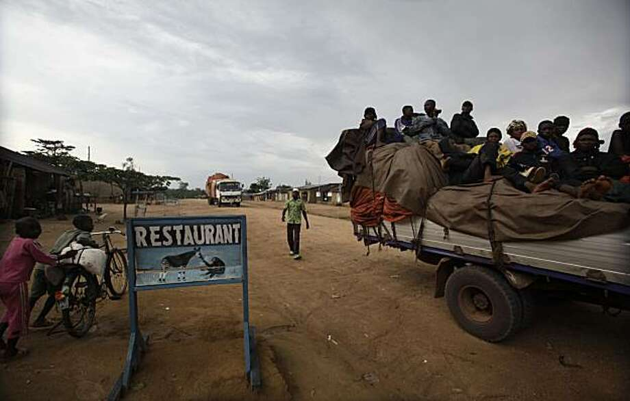 In this March 25, 2010 photo, a truck loaded with passengers stops outside a restaurant serving bush meat, in the town of Epulu, Congo in the heart of the Okapi Wildlife Reserve. The pygmies' traditional practice of hunting bushmeat has devolved into an all-out commercial endeavor, staged not for subsistence, but to feed growing regional markets. The result: the forests, those that remain, are growing emptier by the day. Photo: Rebecca Blackwell, AP