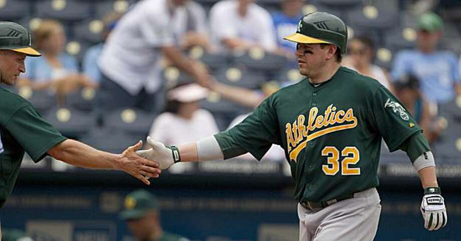 Oakland Athletics' Jack Cust (32) celebrates with Mark Ellis after Cust hit a three-run home run during the ninth inning of a baseball game against the Kansas City Royals Sunday, July 18, 2010 in Kansas City, Mo. Photo: Charlie Riedel, AP