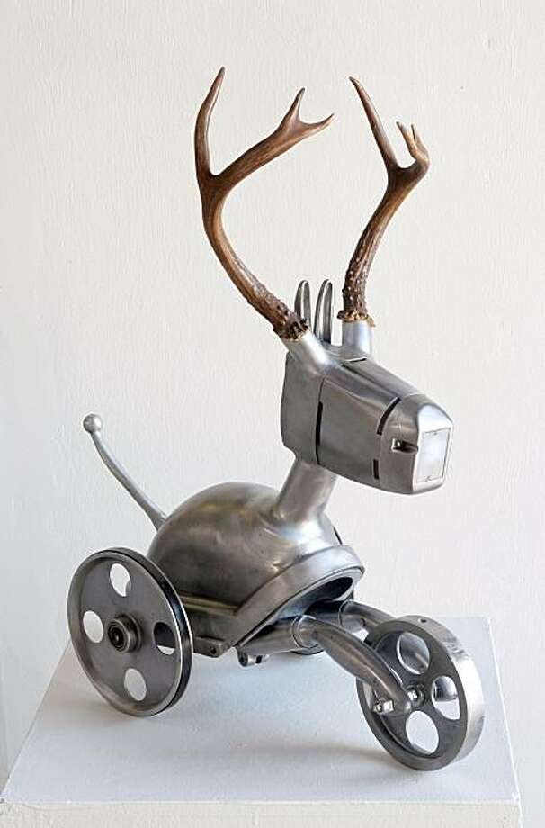 Nemo Gould, Impala, 2007. Electric sander, band saw, projector, vacuum cleaners, meat grinder,  motorcycle clutch lever, antlers, garlic press, conduit cover, 23 x 9 x 21 in. Photo: Photo: Larry Strong