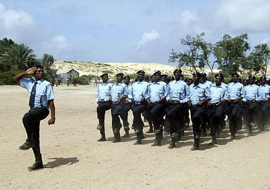Somali police officers march during a parade at the Somali police Academy in Mogadishu, Somalia, Wednesday, July 21, 2010. Somali Prime Minister Omar Abdirashid who attended the graduation ceremony of four months training of hundreds of police officers said that the officers will participate fighting between Somali government backed by AU forces and  Al-Shabaab. Photo: Mohamed Sheikh Nor, AP