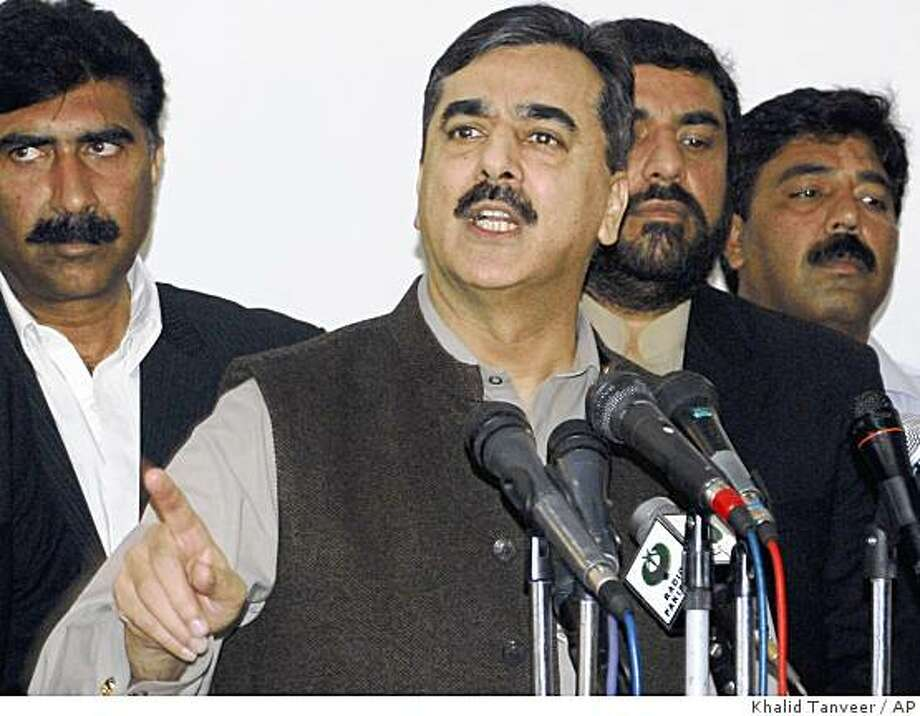 Pakistan's Prime Minister Yousuf Raza Gilani addresses reporters in Multan, Pakistan, on Wednesday, Dec. 10, 2008. The prime minister says Pakistan has detained a second alleged mastermind of the Mumbai terror attacks, apparently making good on pledges to pursue the perpetrators.   (AP Photo/Khalid Tanveer) Photo: Khalid Tanveer, AP