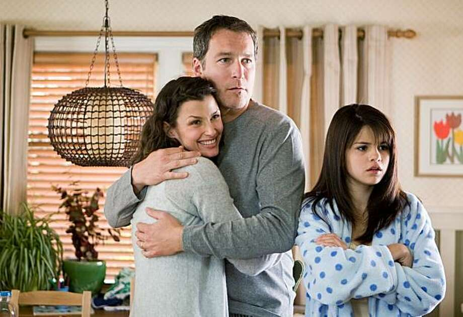 "In this film publicity image released by 20th Century Fox, from left, Bridget Moynahan, John Corbett and Selena Gomez are shown in a scene from, ""Ramona and Beezus."" Photo: Alan Markfield, AP"