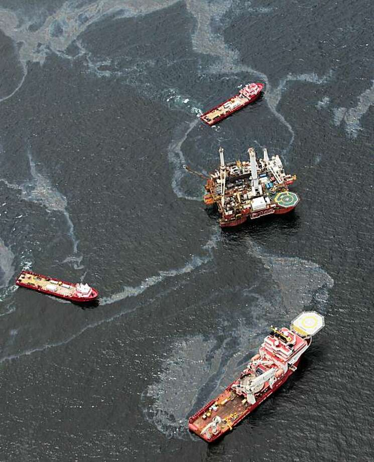 Workboats operate near the Transocean Development Drilling Rig II at the site of the Deepwater Horizon incident in the Gulf of Mexico Friday, July 16, 2010. The wellhead has been capped and BP is continuing to test the integrity of the well before resuming production. Photo: Dave Martin, AP
