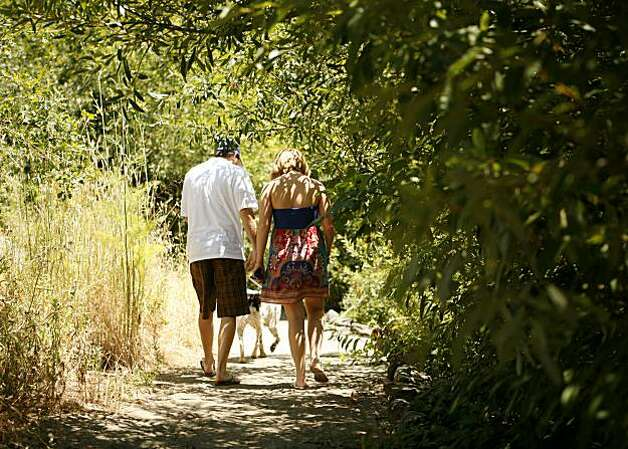 A couple walks along the Prince Memorial Greenway, a half-mile pedestrian and biker creek-side trail which stretches from Santa Rosa City Hall to Railroad Square, on Saturday July 10, 2010 in Santa Rosa, Calif. Photo: Jasna Hodzic, The Chronicle