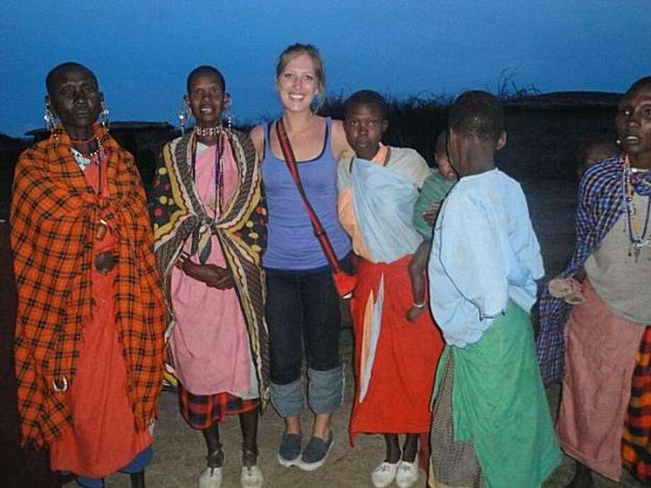 Chelsea Follett of San Francisco visiting a Masai tribe in their village outside of Masai Mara. Photo: Courtesy Of Chelsea Follett