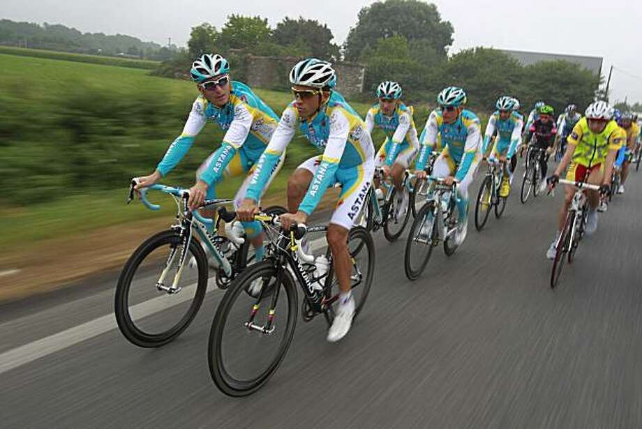 Overall leader Alberto Contador of Spain, front right, rides next to teammate Andriy Grivko of the Ukraine, during a training on the second rest day of the Tour de France cycling race in Pau, Pyrenees region, France, Wednesday, July 21, 2010. Photo: Bas Czerwinski, AP