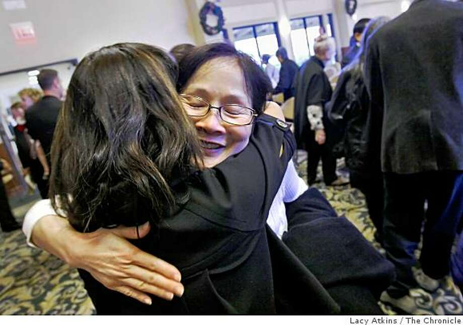 Edna Chang-Grant, left greets cousin Eva Cheung at the end of her parents memerial service, Sunday Dec. 14,  2008  in Walnut Creek, Calif. Her parents were Hugh Hou Chun Chang and his wife Elsi Lan,both in their 90's, and were killed in a boating accident on Thanksgiving while traveling in Venezuela. Photo: Lacy Atkins, The Chronicle