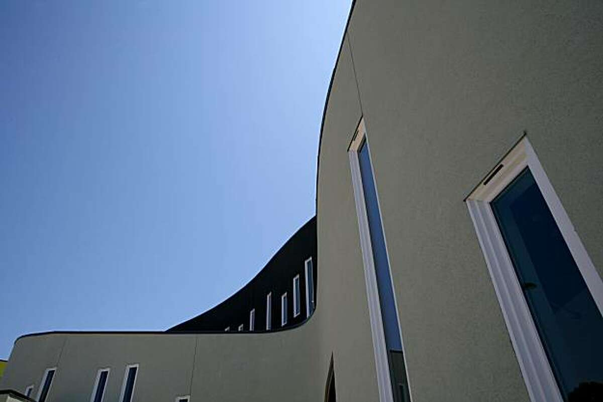 """The """"dragon's tail"""" shaped facade leading into the leasing office of Tassafaronga Village designed by Architect David Baker and his firm on Friday, July 16, 2010 in Oakland, Calif."""