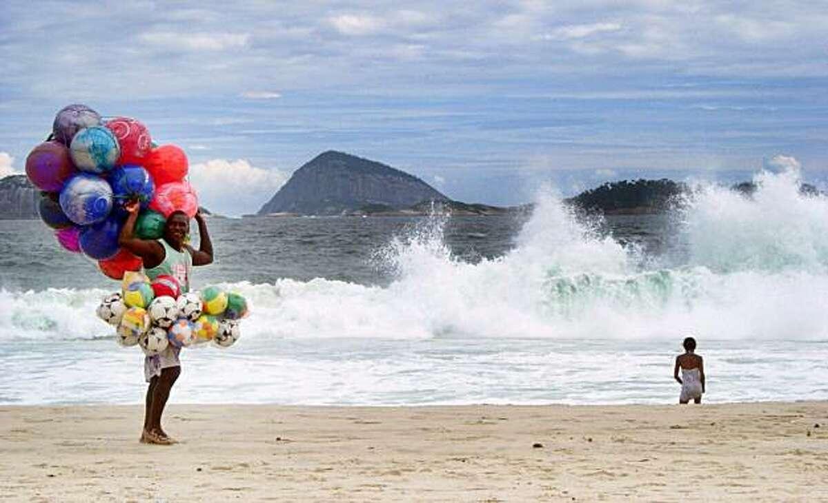 A vendor makes the rounds on Rio de Janeiro's Ipanema Beach.