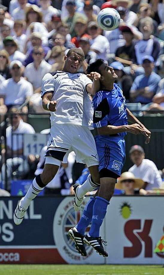 Tottenham's Jermaine Jenas, left, battles for a header against San Jose Earthquakes' Chris Wondolowski during the first half of an international friendly soccer match in Santa Clara,  Saturday, July 17, 2010. Photo: Marcio Jose Sanchez, AP