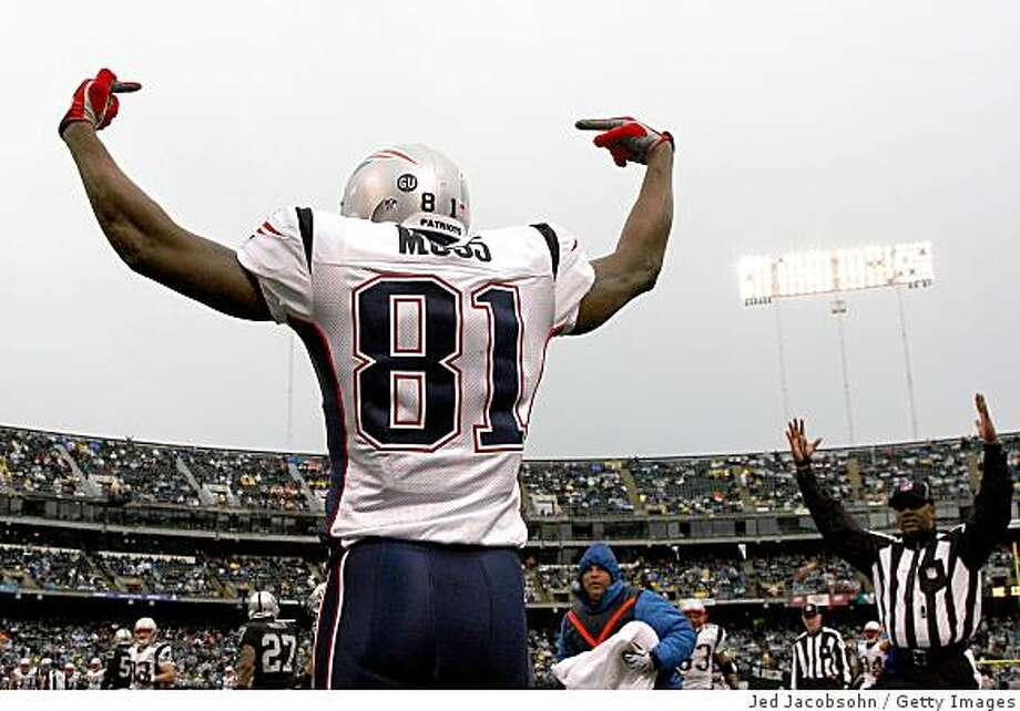 OAKLAND, CA - DECEMBER 14:  Randy Moss #81 of the New England Patriots celeberates after scoring a touchdwon against the Oakland Raiders during an NFL game on December 14, 2008 at the Oakland-Alameda County Coliseum in Oakland, California.  (Photo by Jed Jacobsohn/Getty Images) Photo: Jed Jacobsohn, Getty Images