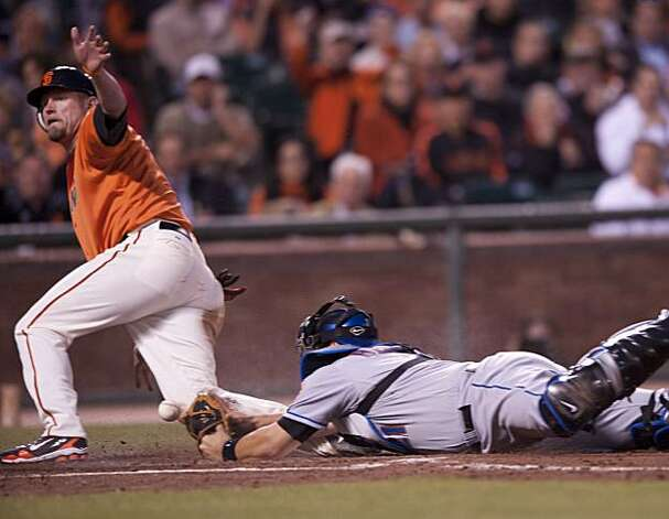 Aubrey Huff slides into Mets catcher Rod Barajas knocking the ball loose and scoring the Giants only run in the 4th inning as the San Francisco Giants compete against the New York Mets on Friday, July 16, 2010 at AT&T Park in San Francisco Calif. Photo: Chad Ziemendorf, The Chronicle