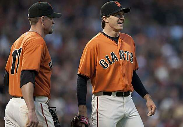Barry Zito and Aubry Huff laugh after Huff called off Zito to catch a fly ball against the New York Mets on Friday at AT&T Park. Photo: Chad Ziemendorf, The Chronicle