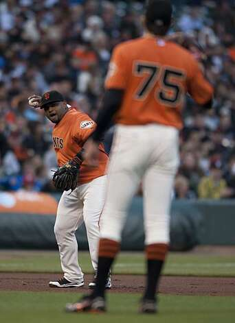Barry Zito waits to catch a ball from third baseman Juan Uribe after striking out a New York Mets batter in the second inning Friday at AT&T Park. Photo: Chad Ziemendorf, The Chronicle