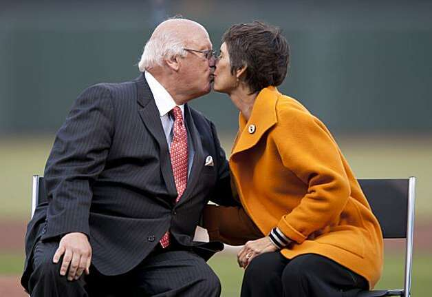 Hall of Fame announcer Jon Miller gets a kiss from his wife, Janine, at his ceremony prior to the Giants' game against the New York Mets on Friday at AT&T Park. Photo: Chad Ziemendorf, The Chronicle