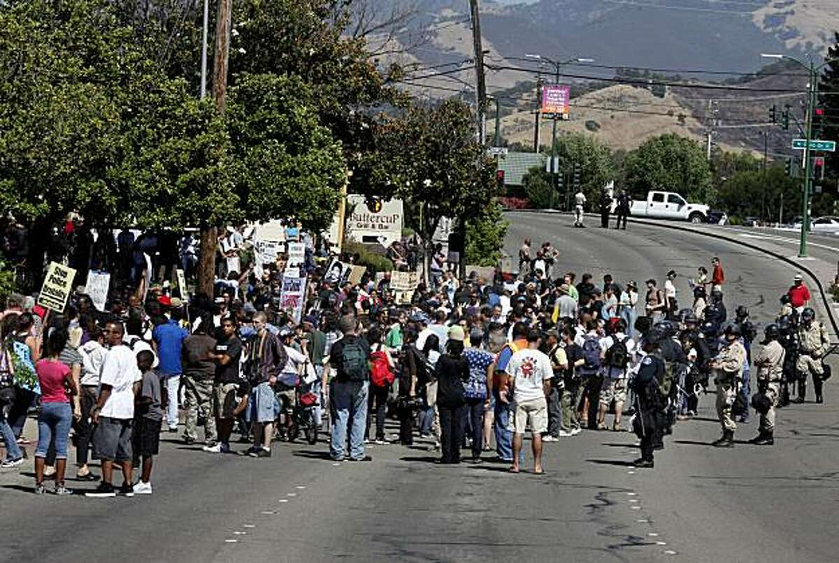 Police blocked off Ygnacio Valley Road as Monday's protest grew in size. A group organized on Facebook held a rally in downtown Walnut Creek in support of Johannes Mehserle and was met by a large contingent of Oscar Grant supporters.