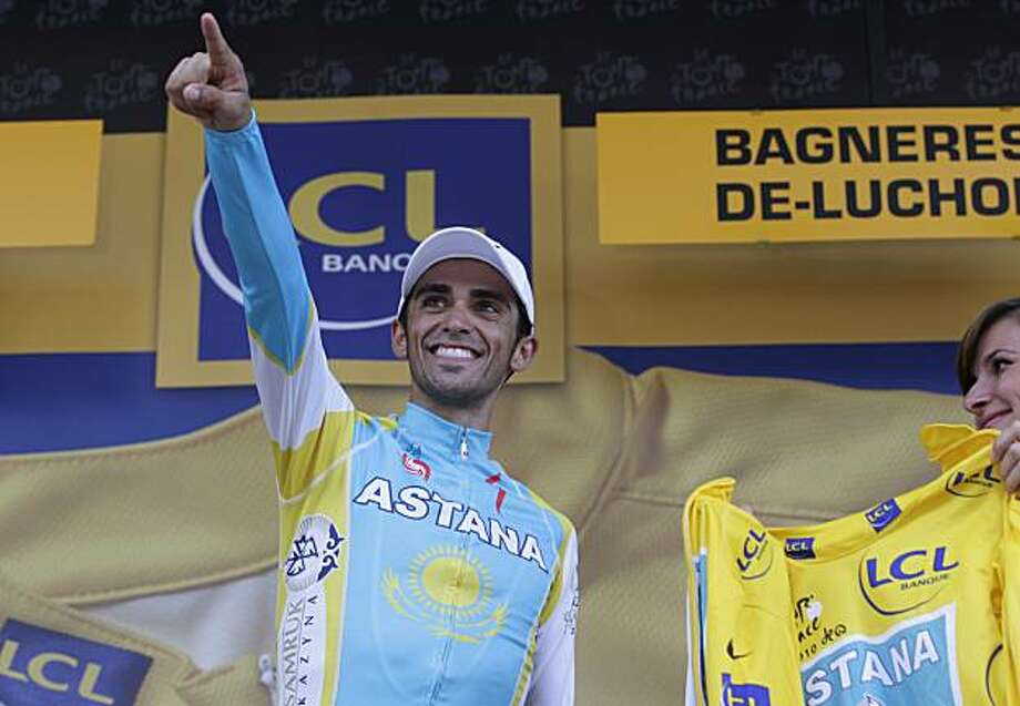 New overall leader Alberto Contador of Spain points on the podium after the 15th stage of the Tour de France cycling race over 187.5 kilometers (116.5 miles) with start in Pamiers and finish in Bagneres-de-Luchon, Pyrenees region, France, Monday, July 19,2010. Photo: Bas Czerwinski, AP