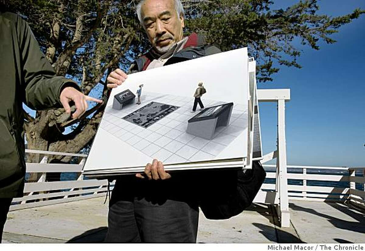 Interpretive Designer, Daniel Quan, holds an artist rendition of what visitors will see as they step onto the Immigration Center boat dock, at the Angel Island Immigration Center, in Tiburon, Calif.