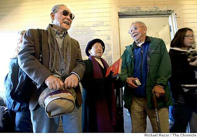 Don Lee, 81, Li Keng Won, 82 and Dale Ching, 87, pause on the second floor of the barracks building, all three were  immigrants who arrived at the Angel Island Immigration Center, in Tiburon, Calif. waiting for approval to come into America. Photo: Michael Macor, The Chronicle