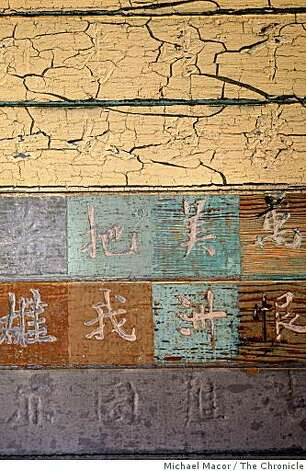 Chinese poems and characters still remain etched into the wood covered walls of the second floor in the men's barracks, left behind by immigrants who arrived at the Angel Island Immigration Center, in Tiburon, Calif., waiting to gain entry into America. Photo: Michael Macor, The Chronicle