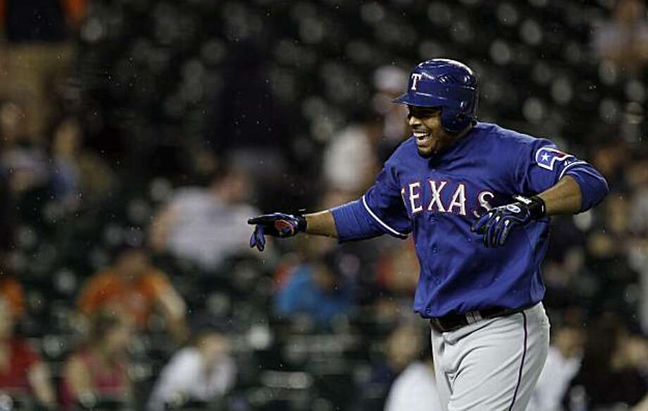 Texas Rangers' Nelson Cruz celebrates after hitting a two-run home run against the Detroit Tigers in the 14th inning of a MLB baseball game in Detroit, Monday, July 19, 2010. Photo: Paul Sancya, AP