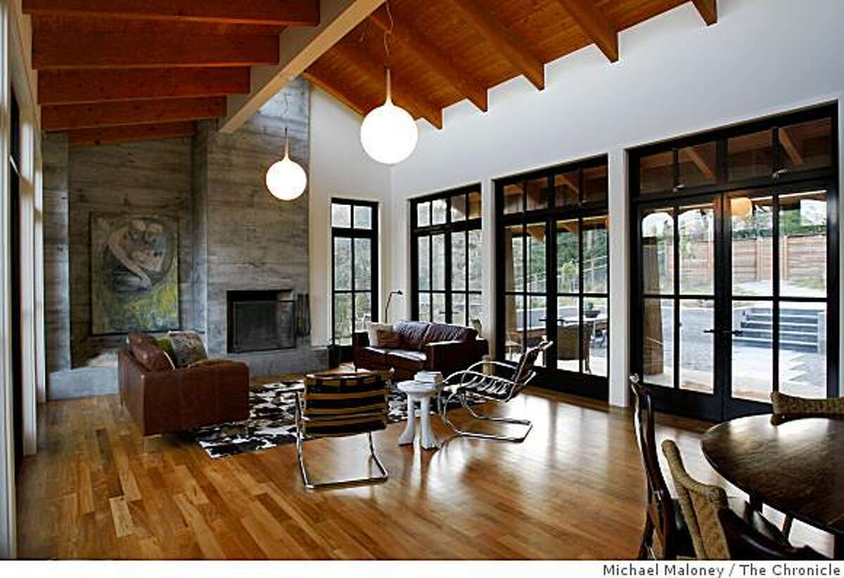 The living room of the Inverness, Calif., home of Adam and Megan Neale. photographed on December 8, 2008, features high wood beamed ceiling and lots of windows.
