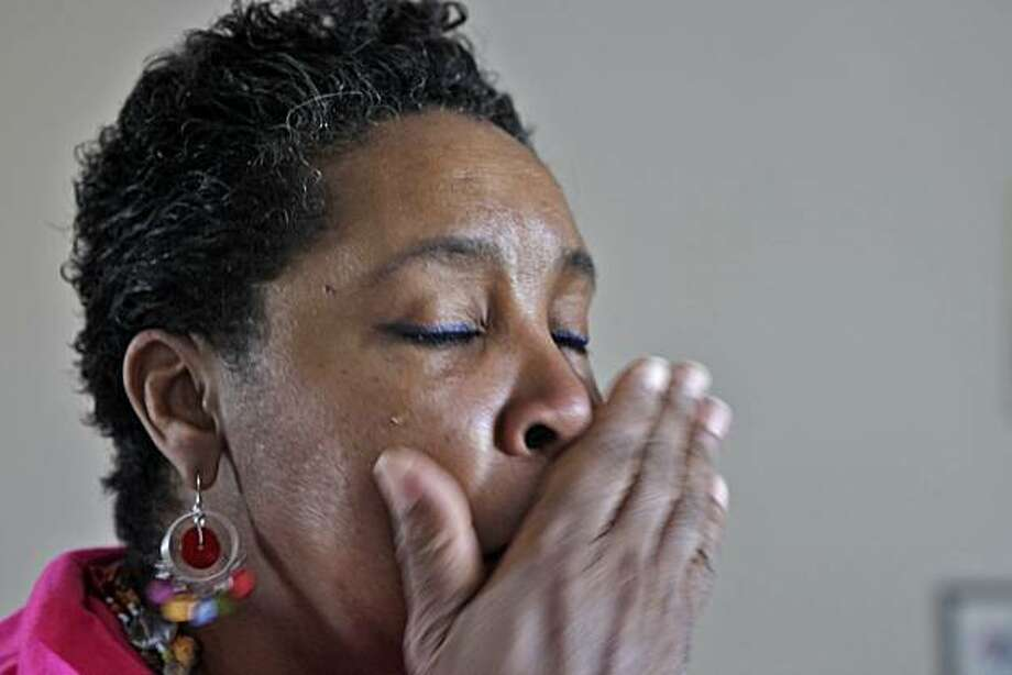 Lenora McCall, cries as she remembers hearing the last words of her daughter,  as she goes through some family pictures,  May 10, 2010, in California. Her daughter Milika Fields, was gunned down two years ago in San Francisco, leaving Lenora to care for her six grand children. The Trauma Recovery Center has been treating Lenora and hundreds of patients this year. Photo: Lacy Atkins, The Chronicle