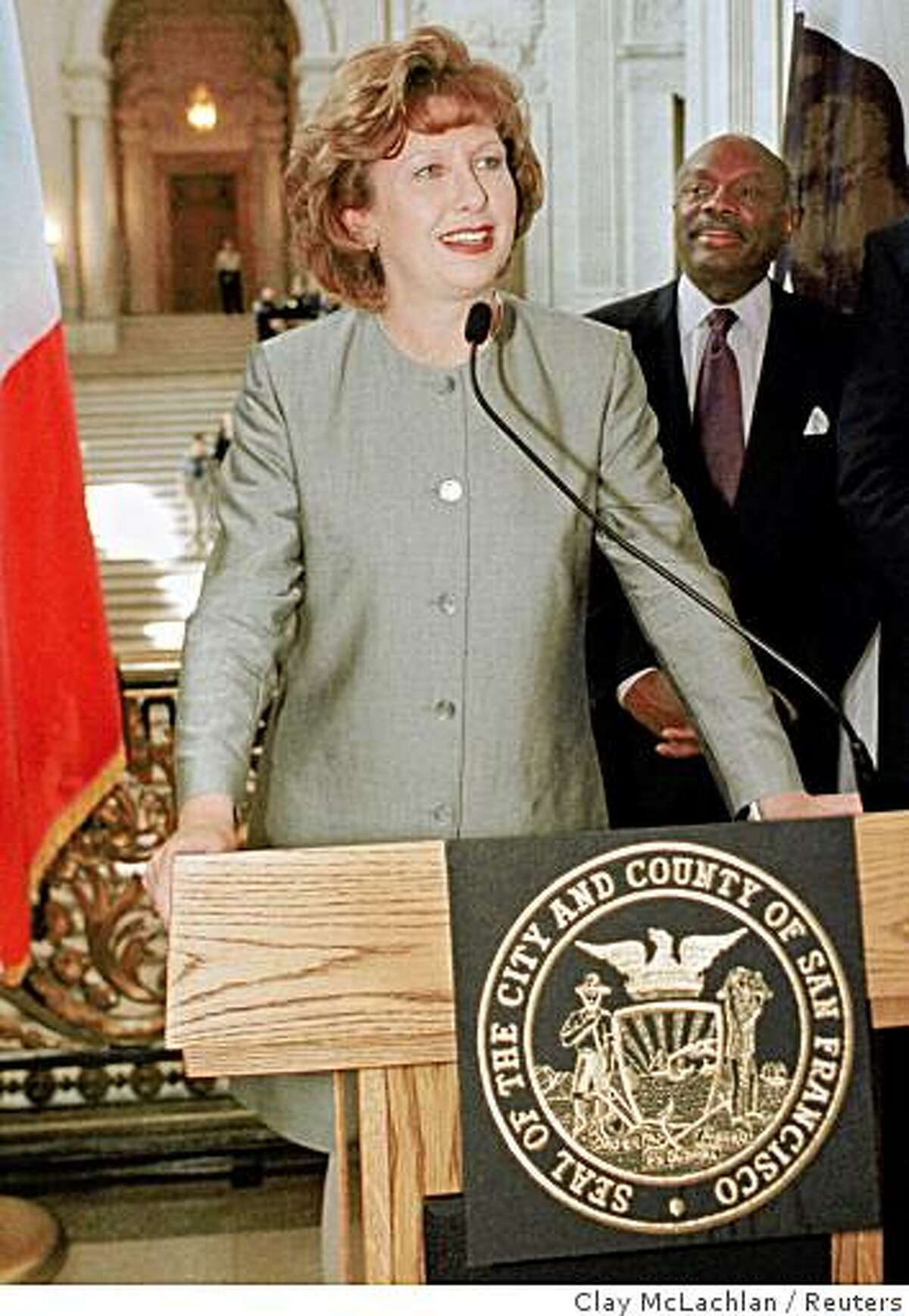 SAF01:MCALEESE-IRELAND:SAN FRANCISCO,21SEP99 - Mary McAleese (L), president of the Republic of Ireland, addresses guests at San Francisco City Hall, September 21. San Francisco Mayor Willie Brown (R) listens to her talk about her visit. cbm/Photo by Clay McLachlan REUTERS