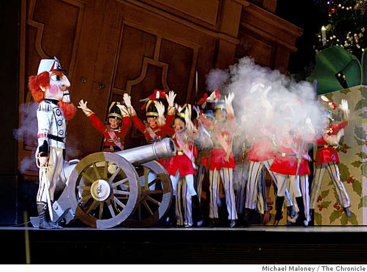 The Nutcracker summons the toy soldiers from the cupboard, and fires a cannon during a battle with the mice during rehearsal of San Francisco Ballet's Nutcracker at the War Memorial Opera House in San Francisco on December 11, 2008.