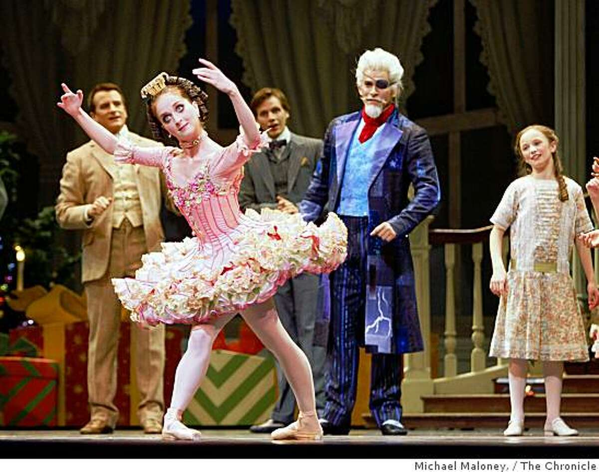 Drosselmeyer, played by Ricardo Bustamante, center, entertains guests with magic and presents including a doll, left, in the sitting room of the Stahlbaum house during rehearsal of San Francisco Ballet's Nutcracker at the War Memorial Opera House in San Francisco on December 11, 2008.