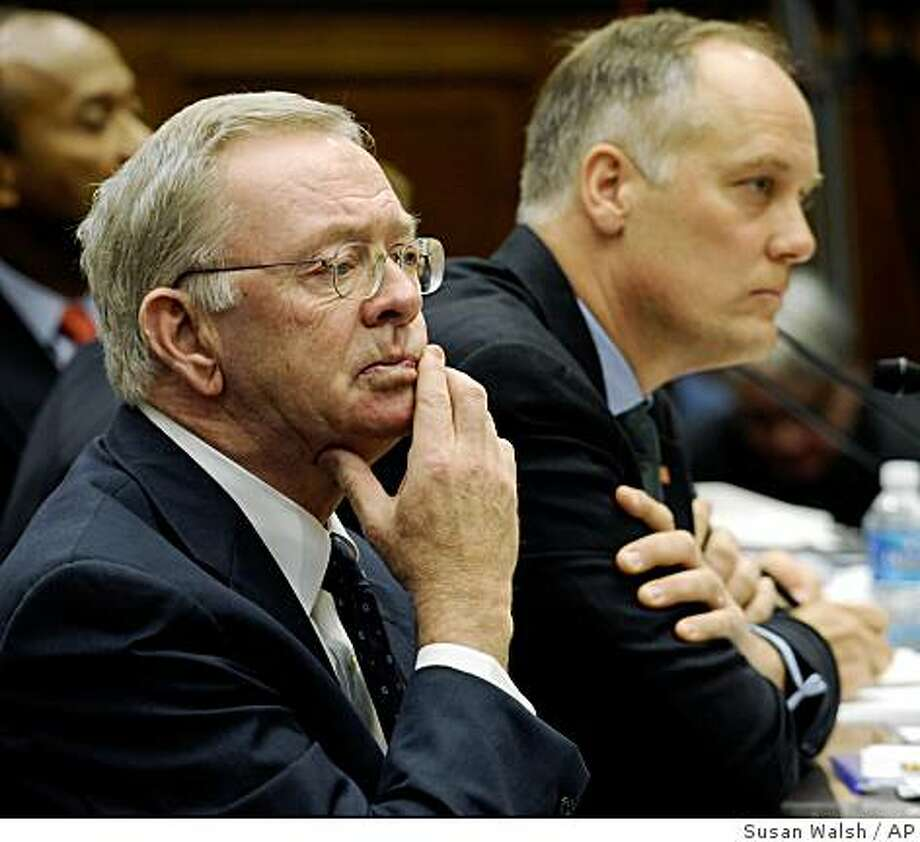 Former Freddie Mac Chief Executive Officer Richard Syron, left, and former Fannie Mae Chief Executive Officer Daniel Mudd, right, listen on Capitol Hill in Washington, Tuesday, Dec. 9, 2008, during the House Oversight and Government Reform Committee hearing on the financial meltdown. (AP Photo/Susan Walsh) Photo: Susan Walsh, AP