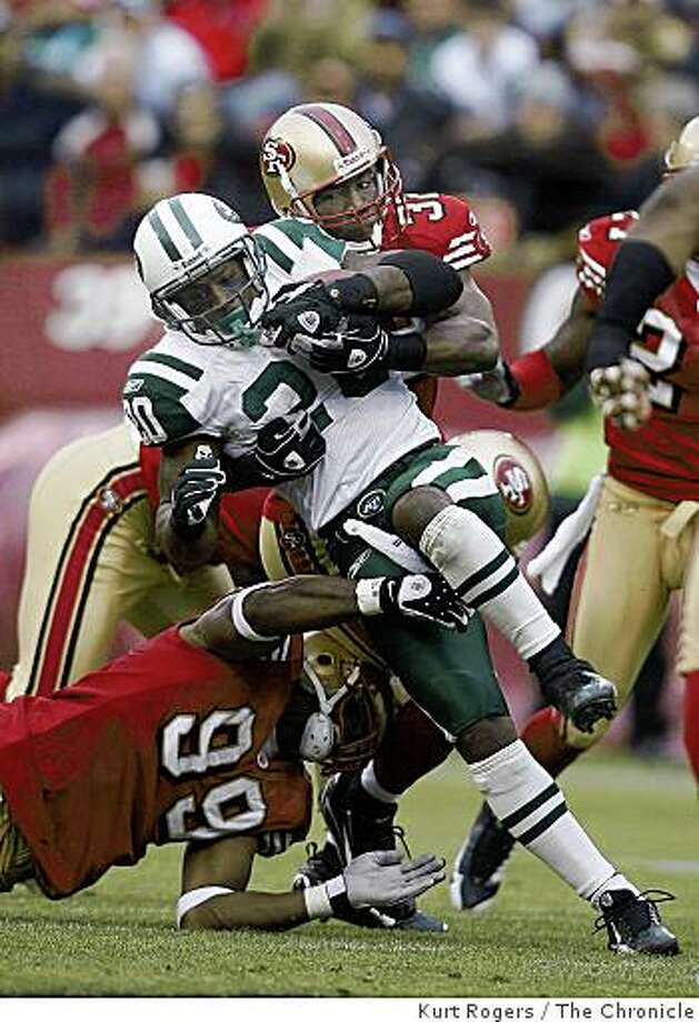 Manny Lawson and Michael Lewis bring down Thomas Jones in the third quarter in the 49er 24-14 win over the New York Jets. on Sunday Dec 7,  2008 in San Francisco, Calif Photo: Kurt Rogers, The Chronicle