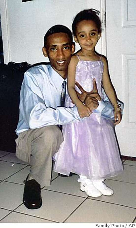 An undated family photo shows Filmon Tesfai, left, and his younger sister, Arsema. Filmon was killed in a drive-by shooting two days before he left for the University of Illinois in 2003 in what police believe was a case of mistaken identity. The case is still unsolved. (AP Photo/Family Photo)  **NO SALES** Photo: Family Photo, AP