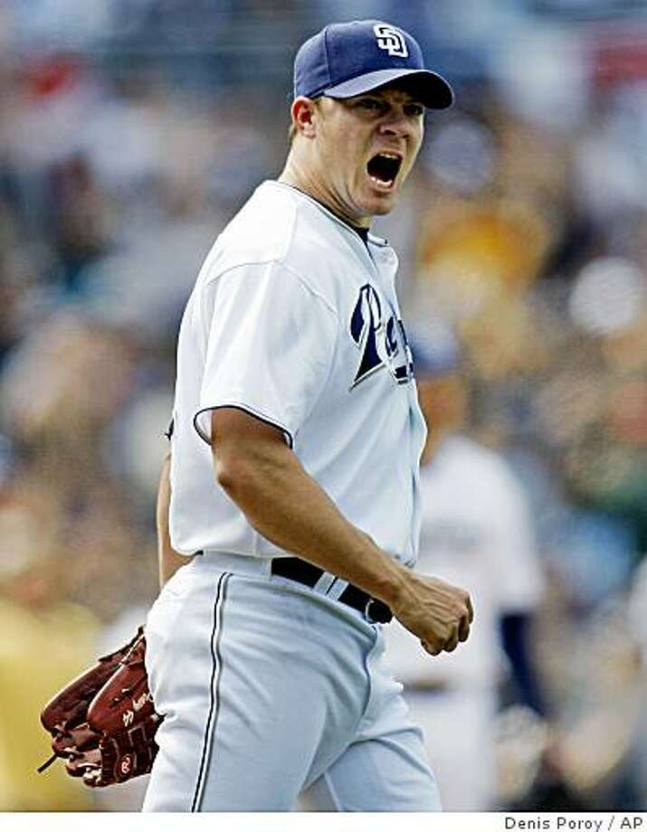 San Diego Padres pitcher Jake Peavy pumps his fist after the Padres turned a double play during ninth inning of a baseball game against the Los Angeles Dodgers Saturday, April 5, 2008, in San Diego.  Peavy pitched a complete game in the Padres 4-1 win.  (AP Photo/Denis Poroy) Photo: Denis Poroy, AP