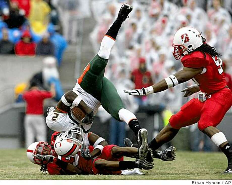 N.C. State's Jeremy Gray (30) tackles Miami's Graig Cooper in the third quarter an NCAA college football game on Saturday,  Nov.  29, 2008 in Raleigh, N.C.   (AP Photo/The News & Observer, Ethan Hyman) Photo: Ethan Hyman, AP
